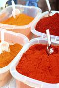 Saffron paprika curry yellow orange spices Stock Photos