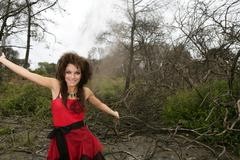 Beautiful woman, black magic on burned forest Stock Photos