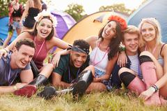 Friends having fun on the campsite at a music festival Stock Photos