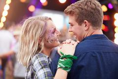 Happy couple in the crowd at a music festival - stock photo