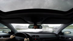 Dash cam car driving panorama on rainy german highway - stock footage