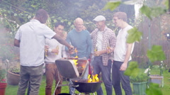 4K Happy mixed ethnicity group of male friends chatting & drinking beer at bbq Stock Footage