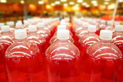 Assembly line bottle red liquid rows lines Stock Photos