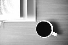 Stock Photo of open book with coffee black and white color tone style