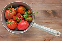 Ripe fresh red tomatoes in a colander Stock Photos