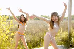 Girls dancing outside in the park in bikini - stock photo