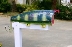 Fun artistic mail box with fish shape Stock Photos