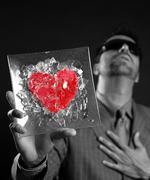 Broken red glass heart businessman metaphor Stock Photos