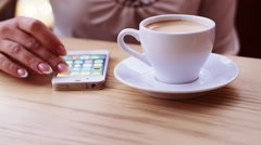 Hand works with cellphone, coffee time Stock Footage