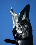 EDITORIAL: Head of the pike sculpture Laulupuut and a seagull - stock photo