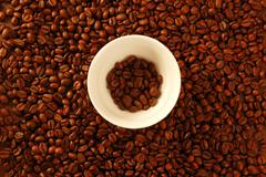 coffee golden brown texture around white cup - stock photo