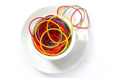 Coffee metaphor with color rubber bands, office Stock Photos