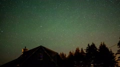 Timelapse of stars rotating above house a night Stock Footage