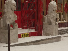 Stone lions in snow, Shenyang, China Stock Footage