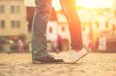 Stock Photo of Couples foots stay at the street under sunlight