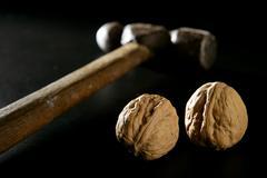 Traditional classic walnut hammer Stock Photos