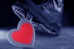 Kill the love or health metaphor Stock Photos