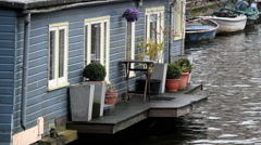 Amsterdam, The Netherlands. Holland. Boat house, canal - stock footage