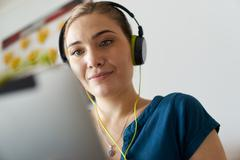 Woman With Green Earphones Listens Podcast Music On Tablet Kuvituskuvat