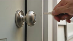 Man Unlocks Home Door and Enters Stock Footage