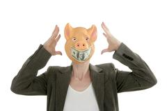 Woman with swine face, dollar note mask - stock photo