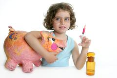 Little girl pretending be veterinary with a pig Stock Photos
