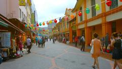 Shoppers Stroll along a Commercial Street in the Indian Quarter of Singapore Stock Footage