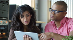 Diverse professional team working together on a tablet Arkistovideo