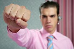 Angry aggresive businessman with fist closeup Stock Photos