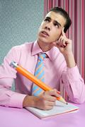 Stock Photo of Education metaphor, student young businessman