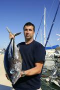 Angler fishing big game Albacore tuna on Mediterranean - stock photo