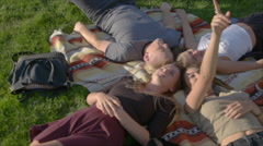 Cute teens stare up at the sky Stock Footage