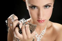 Ambition and greed in fashion woman with jewelry Stock Photos