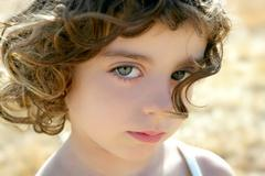 Beautiful little girl portrait outdoo - stock photo