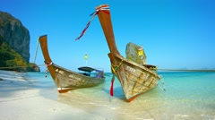 Boats in the Surf at Railay Beach in Thailand Stock Footage