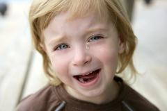 Adorable blond little girl crying portrait Stock Photos