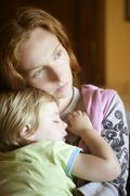 Baby toddler girl sleeping in mother arms - stock photo