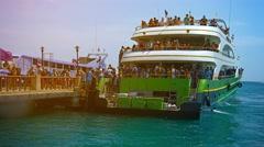 PHI PHI ISLAND, THAILAND - CIRCA FEB 2015: Crowd of Tourists Disembarking fro Stock Footage