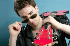 guitar rock star man sunglasses leather jacket - stock photo
