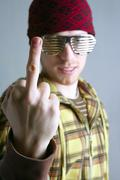 middle finger obscene gesture young cap man - stock photo