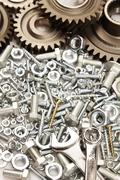 Steel gears, nuts, bolts, and wrenches Stock Photos