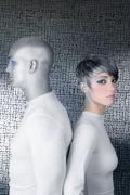 Alien silver future couple silver man fashion woman Stock Photos