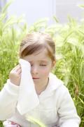 Sad little girl crying outdoor green meadow field Stock Photos