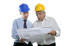 Stock Photo of engineer architect two expertise team plan hardhat