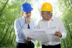 Stock Photo of engineer architect two expertise team plan forest