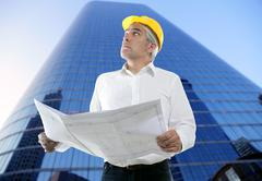 Stock Photo of expertise architect engineer plan looking building