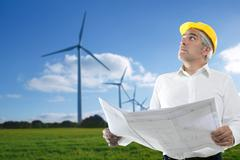 expertise architect senior engineer plan windmill - stock photo