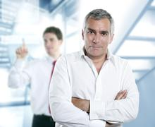 senior gray hair manager in hi-tech office - stock photo