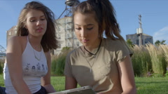 Cute friends use ipad together - stock footage