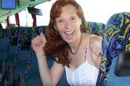 Happy woman tourist traveling bus indoor Stock Photos